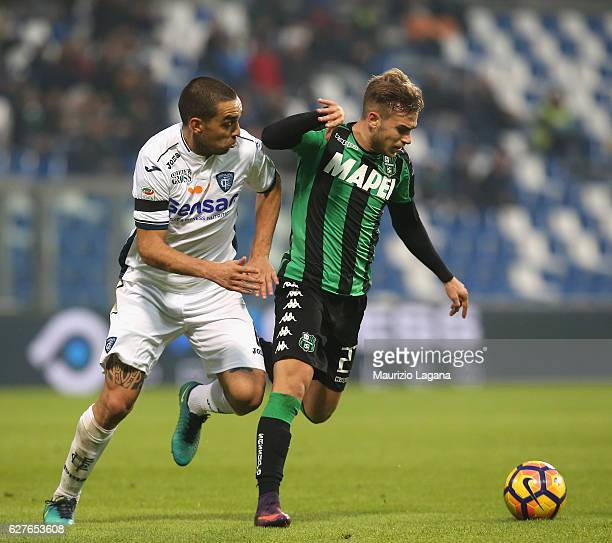 Federico Ricci of Sassuolo competes for the ball with Giuseppe Bellusci of Empoli during the Serie A match between US Sassuolo and Empoli FC at Mapei...