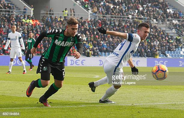 Federico Ricci of Sassuolo competes for the ball with Ivan Perisic of Inter during the Serie A match between US Sassuolo and FC Internazionale at...