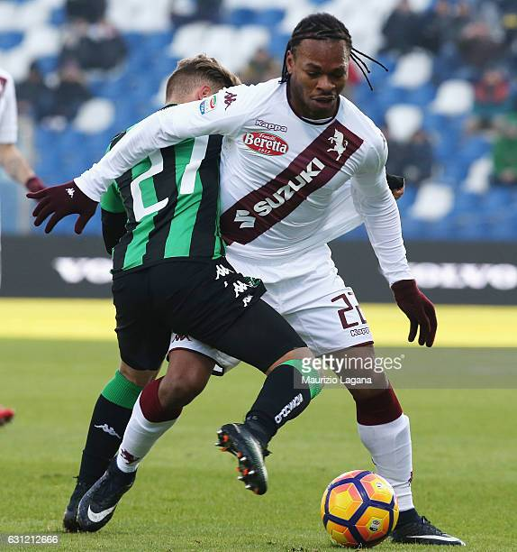 Federico Ricci of Sassuolo competes for the ball with Joel Obi of Torino during the Serie A match between US Sassuolo and FC Torino at Mapei Stadium...