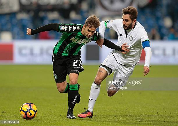Federico Ricci of US Sassuolo Calcio competes for the ball with Francesco Renzetti of AC Cesena during the TIM Cup match between US Sassuolo and AC...