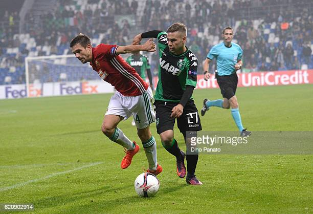 Federico Ricci of US Sassuolo Calcio competes with Thomas Schrammel of SK Rapid Wien during the UEFA Europa League match between US Sassuolo Calcio...