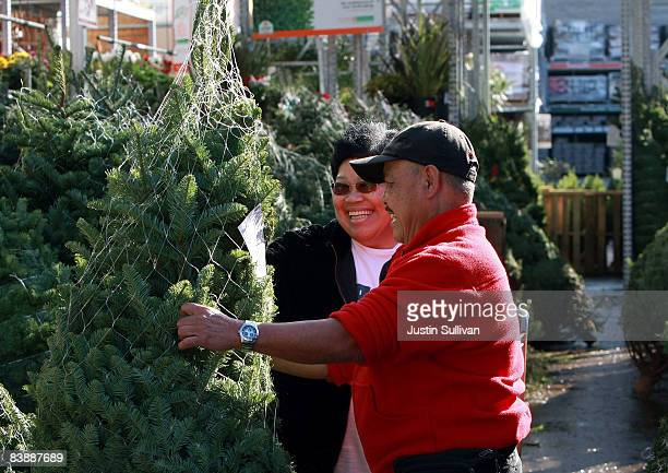 Federico San Andreas and his wife Rosario San Andreas shop for a Christmas tree at a Home Depot store December 2 2008 in Colma California Home Depot...