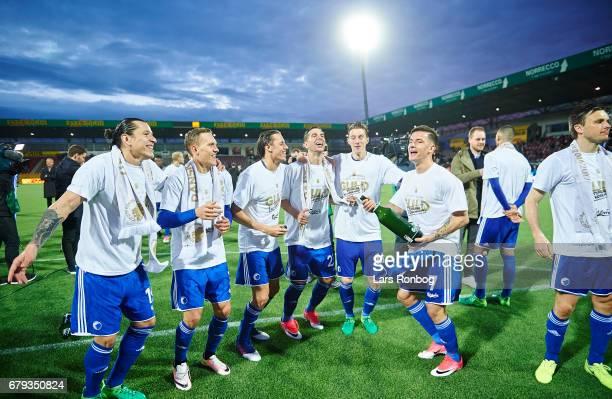 Federico Santander Ludvig Augustinsson Uros Matic Andrija Pavlovic Jan Gregus and Benjamin Verbic of FC Copenhagen celebrate with champagne as danish...