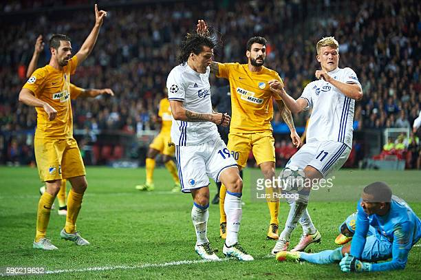 Federico Santander of FC Copenhagen and Andreas Cornelius of FC Copenhagen compete for the ball with Goalkeeper Boy Waterman of Apoel FC during the...