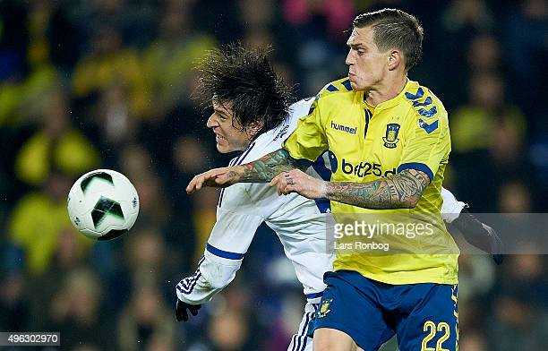 Federico Santander of FC Copenhagen and Daniel Agger of Brondby IF compete for the ball during the Danish Alka Superliga match between Brondby IF and...