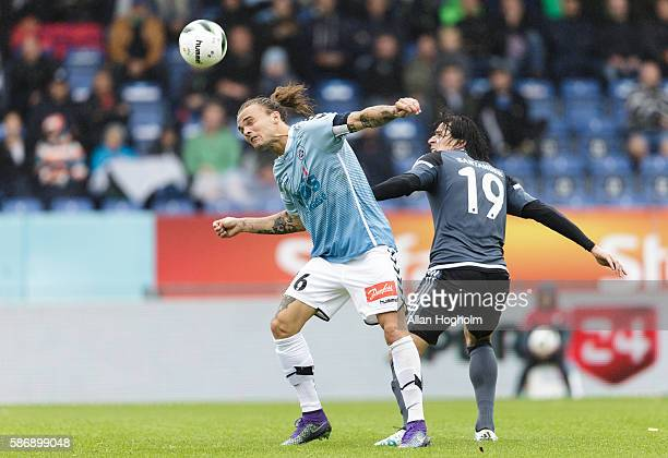 Federico Santander of FC Copenhagen and Pierre Kanstrup of SonderjyskE compete for the ball during the Danish Alka Superliga match between...