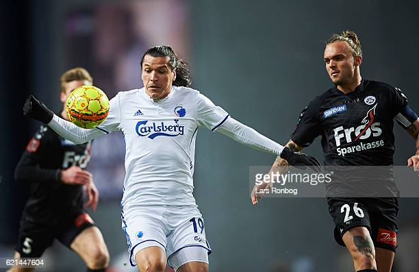 Federico Santander of FC Copenhagen and Pierre Kanstrup of Sonderjyske compete for the ball during the Danish Alka Superliga match between FC...