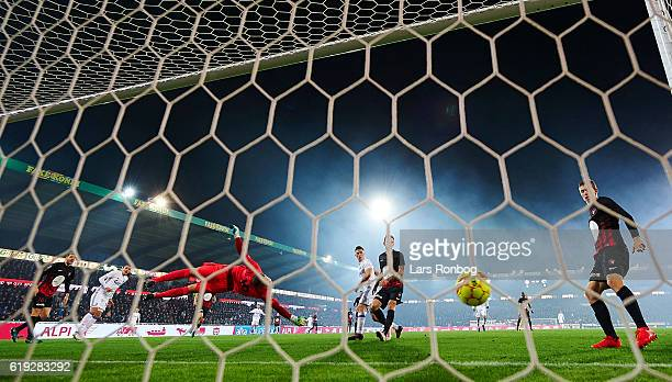 Federico Santander of FC Copenhagen scores the 10 goal against Goalkeeper Johan Dahlin of FC Midtjylland during the Danish Alka Superliga match...