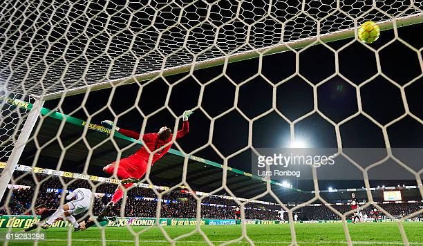 Federico Santander of FC Copenhagen scores the 20 goal against Goalkeeper Johan Dahlin of FC Midtjylland during the Danish Alka Superliga match...