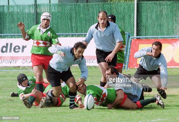 Federico Sciarra from Uruguay tackles an unidentified Moroccan player during their rugby World Cup qualification match 01 May 1999 in Casablanca...