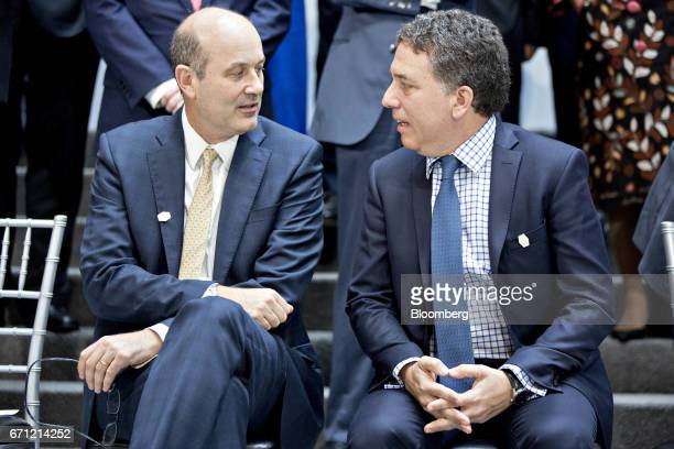 Federico Sturzenegger president of the Central Bank of Argentina left speaks with Nicolas Dujovne Argentina's treasury minister before participating...
