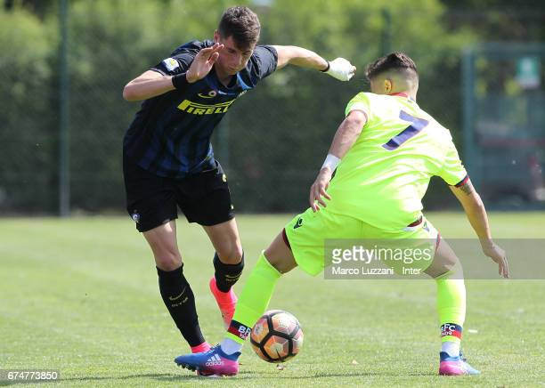 Federico Valietti of FC Internazionale Milano is challenged during the Primavera Tim juvenile match between FC Internazionale and Bologna FC at...
