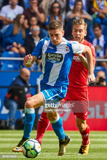 Federico Valverde of Deportivo de La Coruna is challenged by Alvaro Jimenez of Getafe CF during the La Liga match between Deportivo La Coruna and...