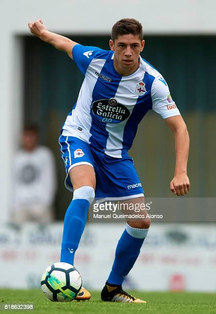 Federico Valverde of Deportivo de La Coruna runs with the ball during the preseason friendly match between Cerceda and Deportivo de La Coruna at O...