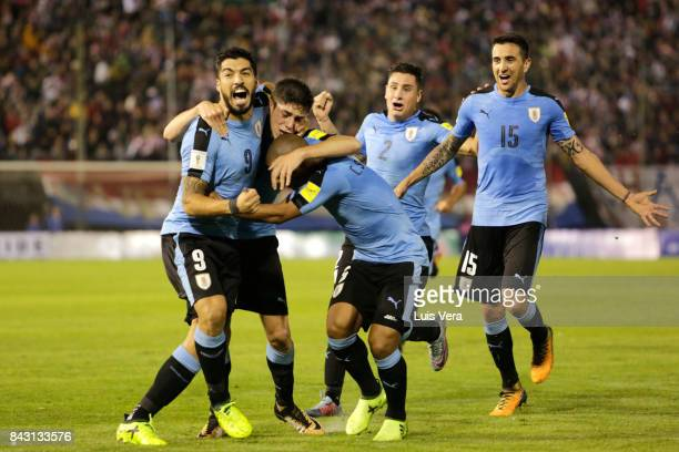 Federico Valverde of Uruguay celebrates with teammates Luis Suarez Carlos Sanchez Matias Vecino and José María Gimenez after scoring the first goal...