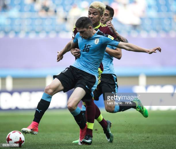 Federico Valverde of Uruguay is challenged by Adalbert Penaranda of Venezuela during the FIFA U20 World Cup Korea Republic 2017 Semi Final match...