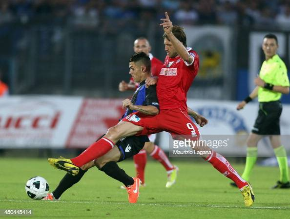 Federico Viviani of Latina competes for the ball with Edgar Cani of Bari during the Serie B playoff match between US Latina and AS Bari at Stadio...