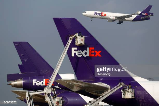 A FedEx Corp jet freighter comes in for a landing at Memphis International Airport in Memphis Tennessee US on Wednesday Sept 18 2013 FedEx Corp...