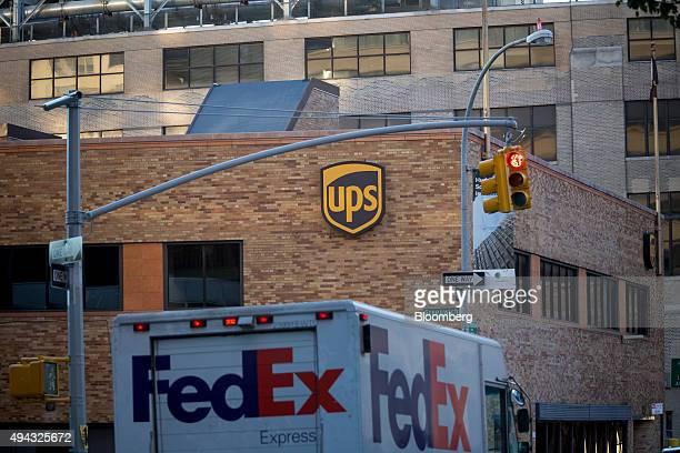 A FedEx Corp truck passes a United Parcel Service Inc facility in New York US on Friday Oct 23 2015 UPS is scheduled to release thirdquarter earnings...