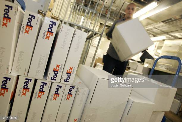 FedEx courier Nate Channing makes a pickup of packages from a Gump's store December 8 2006 in San Francisco California FedEx is beginning to see an...