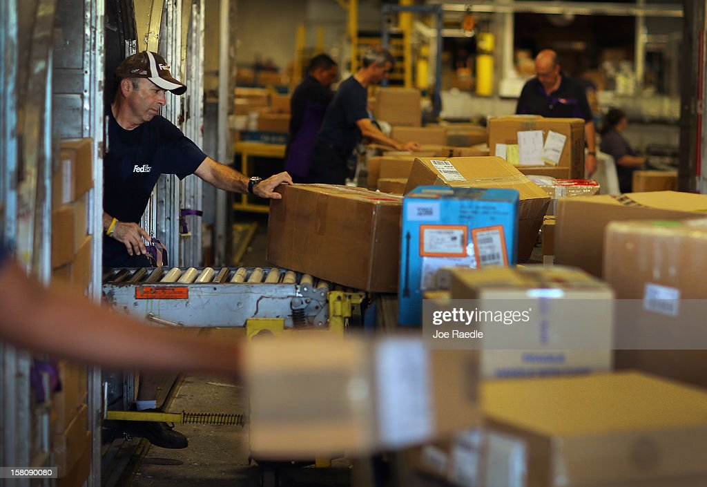 FedEx employee, Javier Belisario, sorts through items being shipped through the Fedex World Service Center on December 10, 2012 in Doral, Florida. FedEx Corp. expects today to be the busiest shippping day of the year when 19 million packages are expected to move through their system.