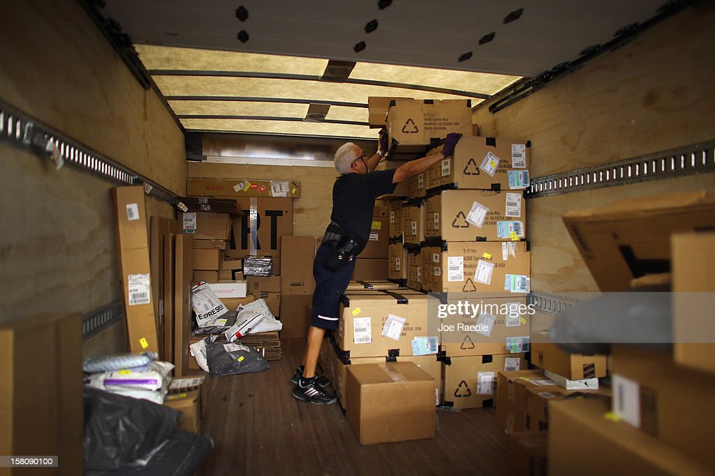 FedEx employee, Victor Alvarez, loads a truck with items for delivery at the Fedex World Service Center on December 10, 2012 in Doral, Florida. FedEx Corp. expects today to be the busiest shippping day of the year when 19 million packages are expected to move through their system.