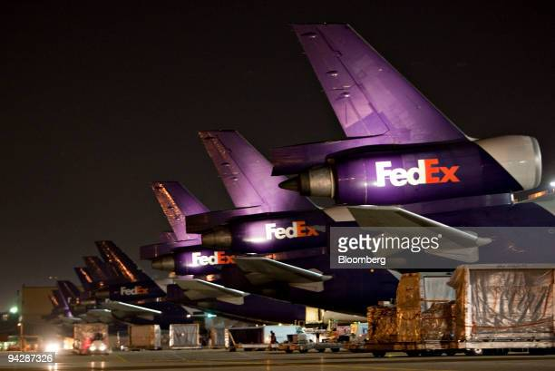FedEx Express MD10 aircraft sit on the tarmac at the FedEx Express hub at Memphis International Airport in Memphis Tennessee US on Friday Dec 11 2009...