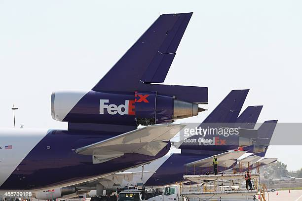 FedEx jets sit at the company's facility at O'Hare International Airport on September 19 2014 in Chicago Illinois In 2013 67 million passengers...