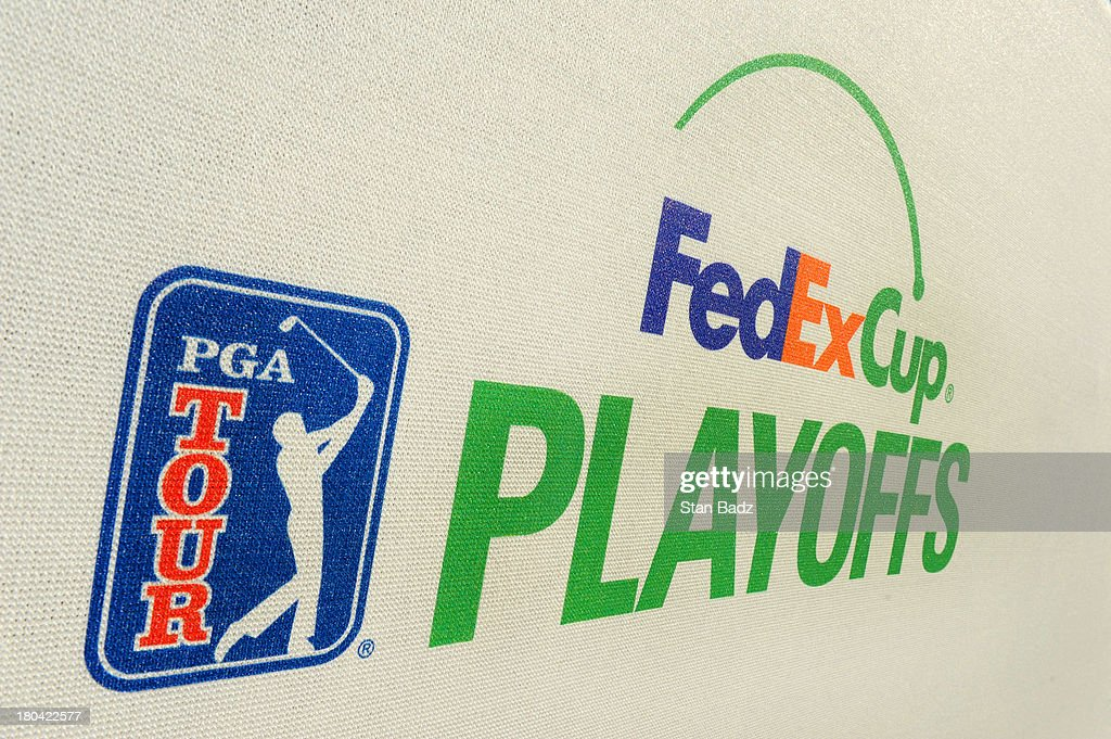FedExCup Playoffs signage is displayed on the 18th hole during the first round of the BMW Championship at Conway Farms Golf Club on September 12, 2013 in Lake Forest, Illinois.