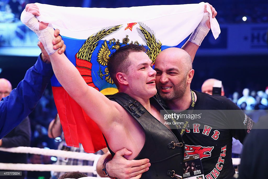 Fedor Chudinov of Russia celebrates with his coach Artur Piduriev after defeating Felix Sturm of Germany in their WBA super middle weight World...