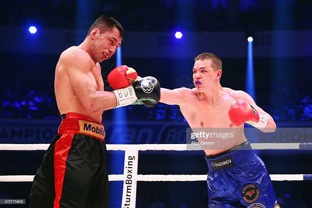 Fedor Chudinov of Russia delivers a punch to Felix Sturm of Germany during their WBA super middle weight World Championship fight at Festhalle on May...