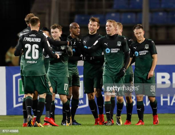 Fedor Smolov of FC Krasnodar celebrates his goal with teammates during the Russian Football League match between FC Tosno and FC Krasnodar on...