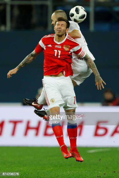 Fedor Smolov of Russia and Andres Iniesta of Spain vie for a header during Russia and Spain International friendly match on November 14 2017 at Saint...