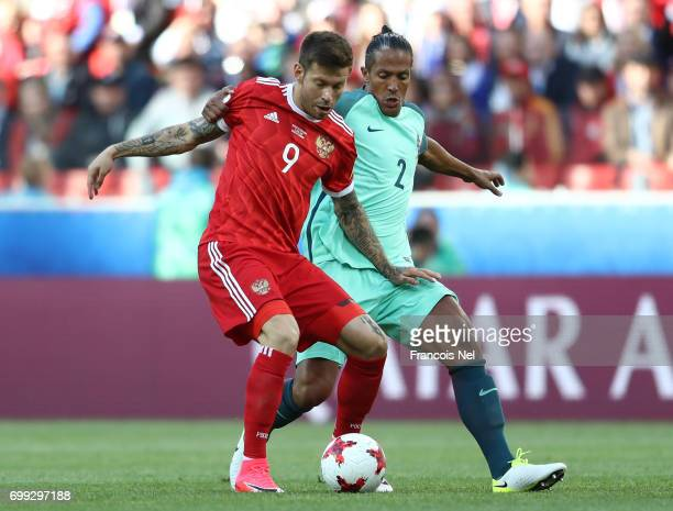 Fedor Smolov of Russia and Bruno Alves of Portugal battle for possession during the FIFA Confederations Cup Russia 2017 Group A match between Russia...
