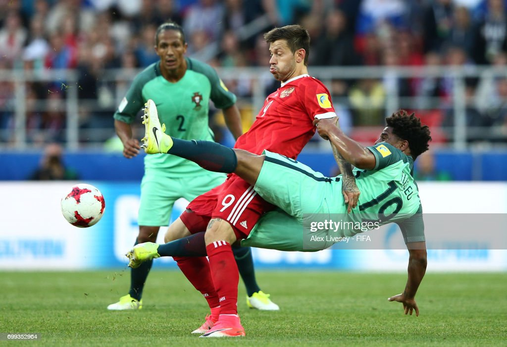 Fedor Smolov of Russia and Eliseu of Portugal battle for possessin during the FIFA Confederations Cup Russia 2017 Group A match between Russia and Portugal at Spartak Stadium on June 21, 2017 in Moscow, Russia.
