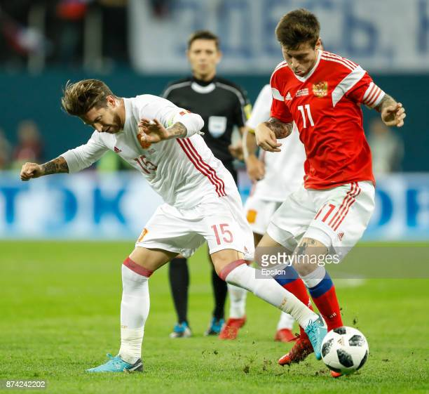 Fedor Smolov of Russia and Sergio Ramos of Spain vie for the ball during Russia and Spain International friendly match on November 14 2017 at Saint...