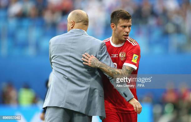 Fedor Smolov of Russia and Stanislav Cherchesov head coach of Russia embrace as he comes off during the FIFA Confederations Cup Russia 2017 Group A...
