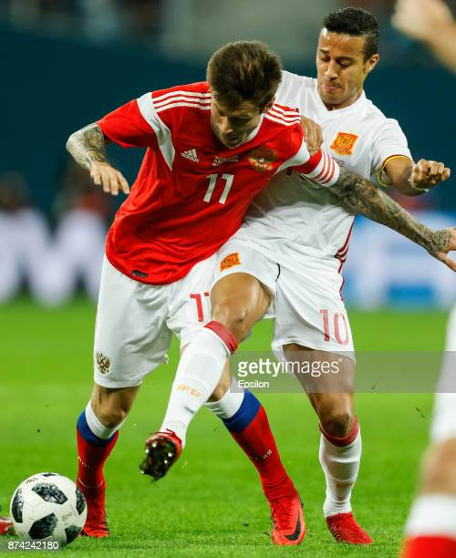 Fedor Smolov of Russia and Thiago Alcantara of Spain vie for the ball during Russia and Spain International friendly match on November 14 2017 at...