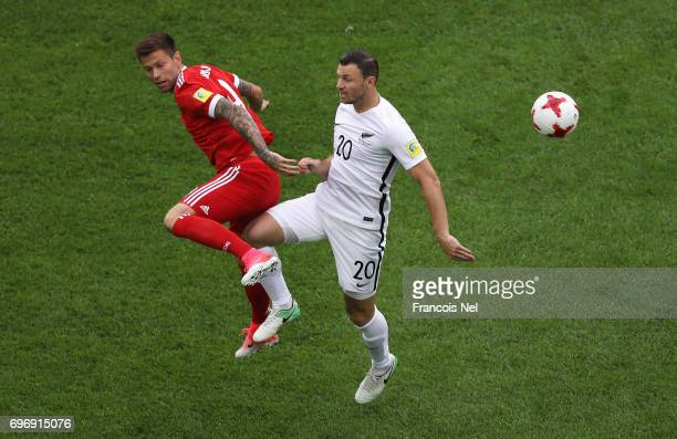 Fedor Smolov of Russia and Tommy Smith of New Zealand battle to win a header during the FIFA Confederations Cup Russia 2017 Group A match between...