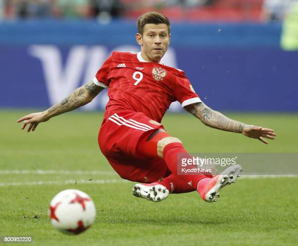 Fedor Smolov of Russia attempts to connect with a cross during the second half of a 21 loss to Mexico in Kazan Russia in a Group A match of the...