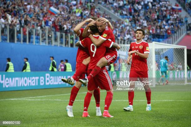 Fedor Smolov of Russia celebrates scoring his sides second goal with his Russia team mates during the FIFA Confederations Cup Russia 2017 Group A...