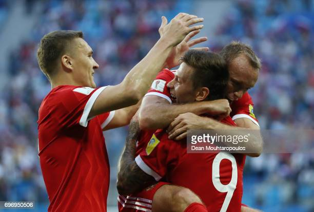 Fedor Smolov of Russia celebrates scoring his sides second goal with his team mates Aleksandr Bukharov and Dennis Glushakov during the FIFA...