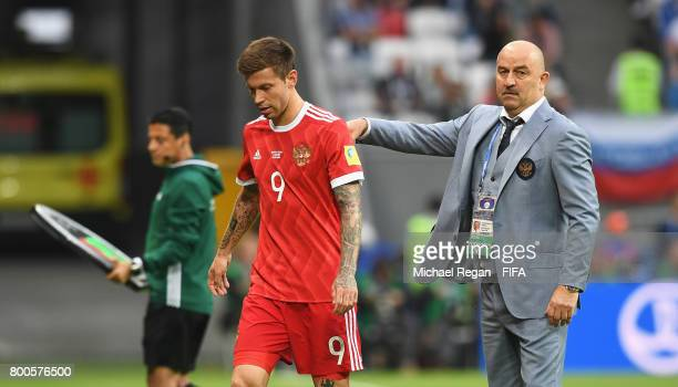 Fedor Smolov of Russia is dejected and Stanislav Cherchesov head coach of Russia attempts to console him after the FIFA Confederations Cup Russia...