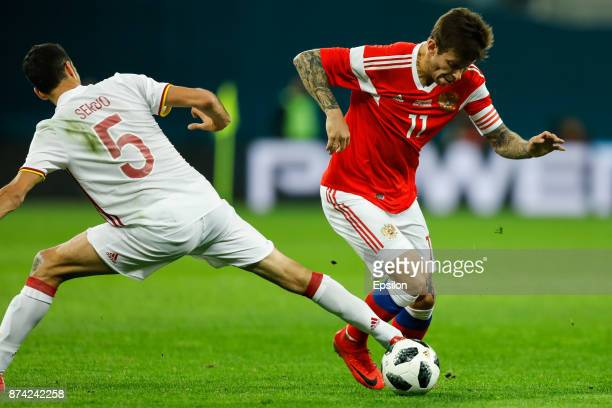 Fedor Smolov of Russia vies for the ball with Sergio Busquets of Spain during Russia and Spain International friendly match on November 14 2017 at...
