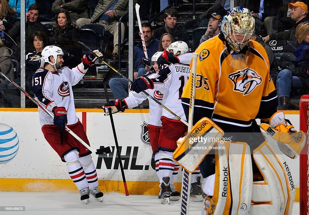 Fedor Tyutin #51, <a gi-track='captionPersonalityLinkClicked' href=/galleries/search?phrase=Cam+Atkinson&family=editorial&specificpeople=6270272 ng-click='$event.stopPropagation()'>Cam Atkinson</a> #13, and <a gi-track='captionPersonalityLinkClicked' href=/galleries/search?phrase=Brandon+Dubinsky&family=editorial&specificpeople=2271907 ng-click='$event.stopPropagation()'>Brandon Dubinsky</a> #17 of the Columbus Blue Jackets celebrate a goal against goalie <a gi-track='captionPersonalityLinkClicked' href=/galleries/search?phrase=Pekka+Rinne&family=editorial&specificpeople=2118342 ng-click='$event.stopPropagation()'>Pekka Rinne</a> #35 of the Nashville Predators at the Bridgestone Arena on April 4, 2013 in Nashville, Tennessee.