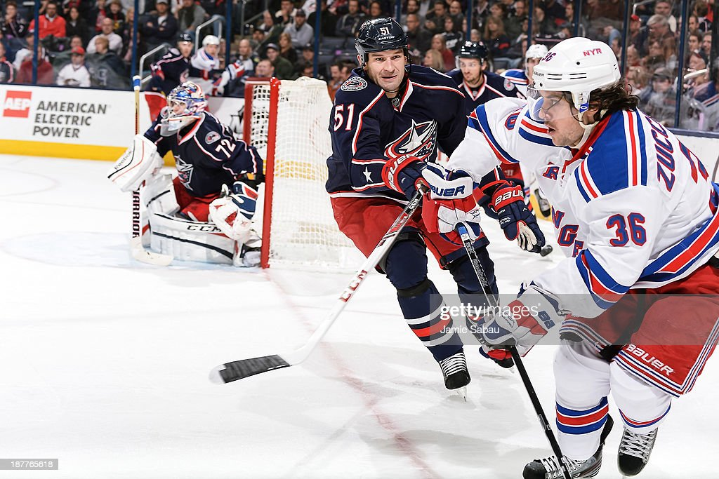 Fedor Tyutin #51 of the Columbus Blue Jackets defends against Mats Zuccarello #36 of the New York Rangers on November 7, 2013 at Nationwide Arena in Columbus, Ohio.