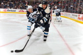 Fedor Tyutin of the Columbus Blue Jackets knocks the puck away from Bryan Little of the Winnipeg Jets during the second period on November 12 2011 at...