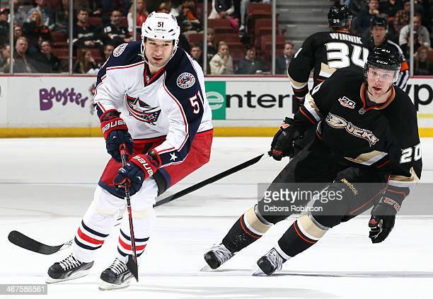 Fedor Tyutin of the Columbus Blue Jackets skates against David Steckel of the Anaheim Ducks on February 3 2014 at Honda Center in Anaheim California