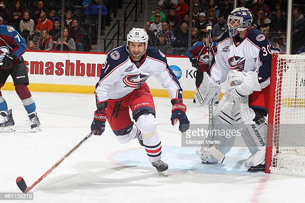 Fedor Tyutin of the Columbus Blue Jackets skates for the puck as goaltender Curtis McElhinney defends the net against the Colorado Avalanche at the...