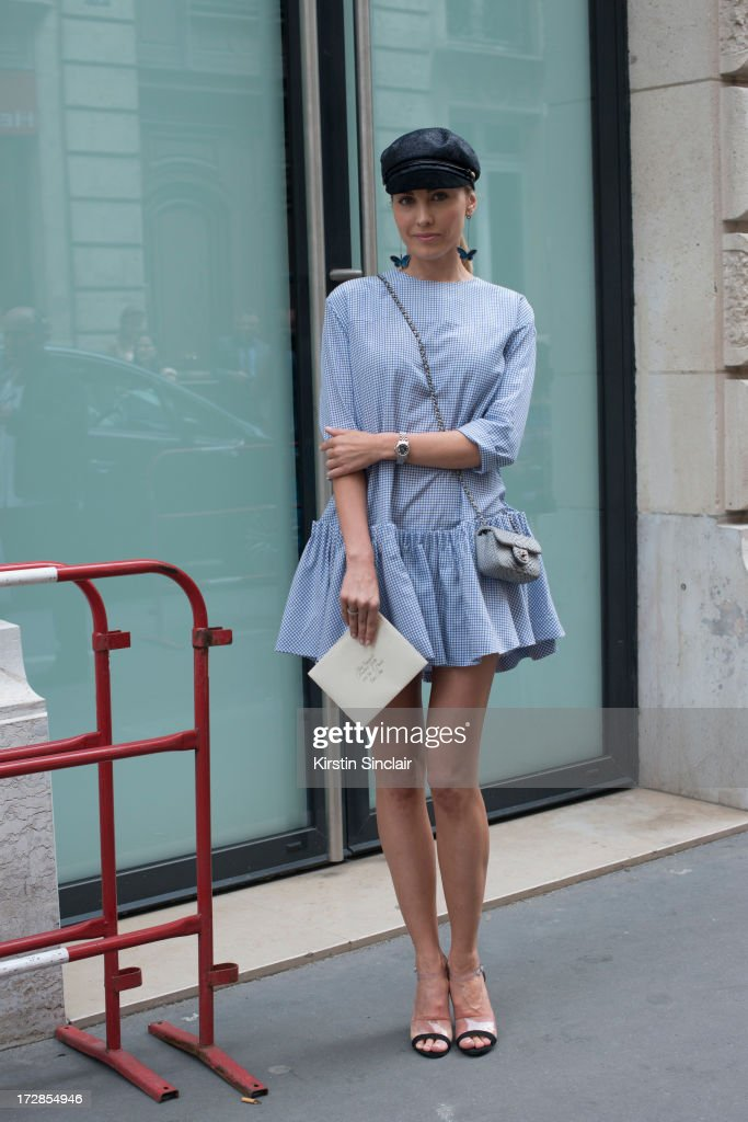 Fedoseeva Luua wears Ulyanna Sergeenko dress, Chanel bag and shoes, Vintage hat on day 2 of Paris Collections: Womens Haute Couture on July 02, 2013 in Paris, France.